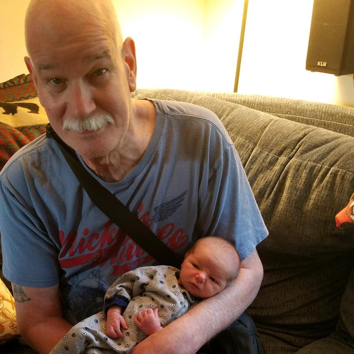 Albert Adams holding a baby