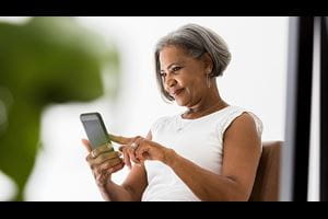 Woman using her phone to get a CPEP evaluation